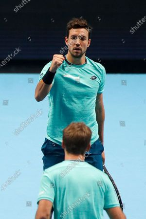Kevin Krawietz of Germany and Andreas Mies of Germany celebrate after winning a point against Rajeev Ram of the United States and Joe Salisbury of Britain during their doubles tennis match at the ATP World Finals tennis tournament at the O2 arena in London