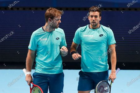 Kevin Krawietz of Germany and Andreas Mies of Germany speak before serving against Rajeev Ram of the United States and Joe Salisbury of Britain during their doubles tennis match at the ATP World Finals tennis tournament at the O2 arena in London