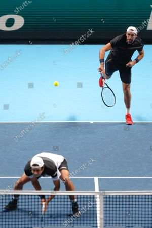 Lukasz Kubot of Poland and Marcelo Melo of Brazil serve to Wesley Koolhof of the Netherlands and Nikola Mektic of Croatia during their doubles tennis match at the ATP World Finals tennis tournament at the O2 arena in London