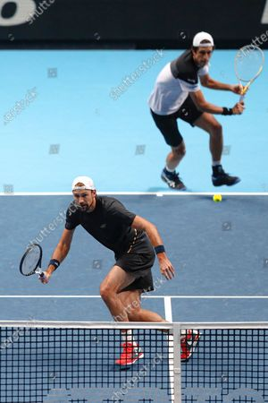 Stock Picture of Lukasz Kubot of Poland and Marcelo Melo of Brazil return to Wesley Koolhof of the Netherlands and Nikola Mektic of Croatia during their doubles tennis match at the ATP World Finals tennis tournament at the O2 arena in London