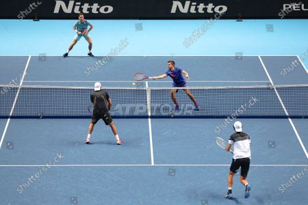 Wesley Koolhof of the Netherlands and Nikola Mektic of Croatia return to Lukasz Kubot of Poland and Marcelo Melo of Brazil during their doubles tennis match at the ATP World Finals tennis tournament at the O2 arena in London