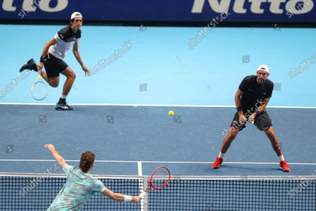 Wesley Koolhof of the Netherlands and Nikola Mektic of Croatia serve to Lukasz Kubot of Poland and Marcelo Melo of Brazil during their doubles tennis match at the ATP World Finals tennis tournament at the O2 arena in London