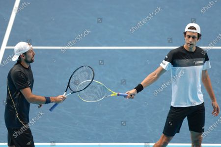 Lukasz Kubot of Poland and Marcelo Melo of Brazil touch rackets during their doubles tennis match against Wesley Koolhof of the Netherlands and Nikola Mektic of Croatiaat the ATP World Finals tennis tournament at the O2 arena in London