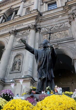 A view of statue of Saint Pope John Paul II in front of the All Saints Church in Warsaw, Poland, 19 November 2020. Pope Saint John Paul II was the head of the Catholic Church and sovereign of the Vatican City State from 1978 until his death in 2005.