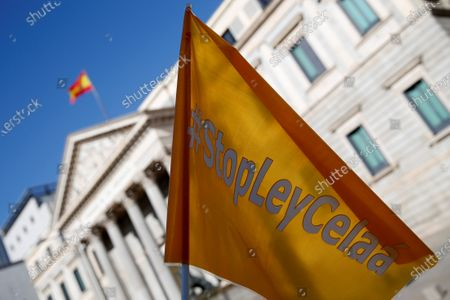 A Spanish flag reads 'Stop Celaa law' during a protest held by members of the platform 'More plural' against the new educational law presented by Spanish Education Minister Isabel Celaa before the building of the Lower House in Madrid, Spain, 19 November 2020. The new education bill is to be voted at the Lower House amidst criticism amongst the opposition parties as the new law would allow regions with a second language such as Catalans, Basques or Galicians to choose in which language students are taught at school.