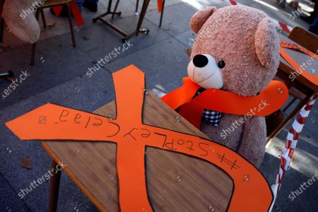 A teddy bear is seen next to an orange ribbon that reads 'Stop Cela law' during a protest held by members of the platform 'More plural' against the new educational law presented by Spanish Education Minister Isabel Celaa before the building of the Lower House in Madrid, Spain, 19 November 2020. The new education bill is to be voted at the Lower House amidst criticism amongst the opposition parties as the new law would allow regions with a second language such as Catalans, Basques or Galicians to choose in which language students are taught at school.