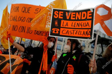 Protesters hold banners reading like 'Spanish language on sale' during a protest held by members of the platform 'More plural' against the new educational law presented by Spanish Education Minister Isabel Celaa before the building of the Lower House in Madrid, Spain, 19 November 2020. The new education bill is to be voted at the Lower House amidst criticism amongst the opposition parties as the new law would allow regions with a second language such as Catalans, Basques or Galicians to choose in which language students are taught at school.