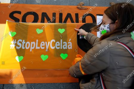 A banner reads 'Stop Celaa law' during a protest held by members of the platform 'More plural' against the new educational law presented by Spanish Education Minister Isabel Celaa before the building of the Lower House in Madrid, Spain, 19 November 2020. The new education bill is to be voted at the Lower House amidst criticism amongst the opposition parties as the new law would allow regions with a second language such as Catalans, Basques or Galicians to choose in which language students are taught at school.