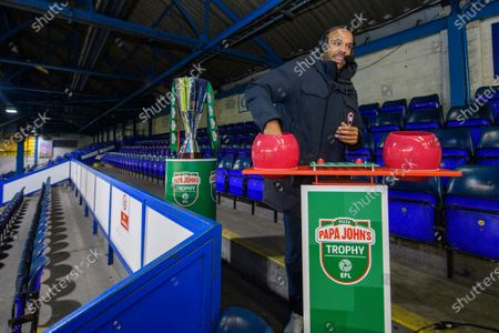 Matt Murray draws the balls during the Papa Johns Trophy draw for the round of 32 fixtures.