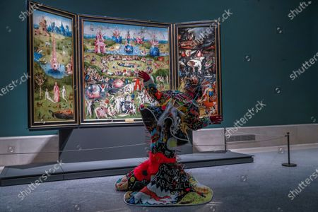Spanish dancer Blanca Maria Gutierrez Ortiz, known as Blanca Li, performs in front of the painting 'The Garden of Earthly Delightsen' by Hieronymus Bosch on occassion of the 201th anniversary of El Prado Museum in Madrid, Spain, 19 November 2020.