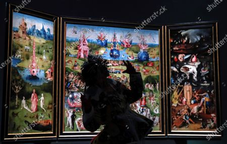 Stock Image of Spanish dancer Blanca Maria Gutierrez Ortiz, known as Blanca Li, performs in front of the painting 'The Garden of Earthly Delightsen' by Hieronymus Bosch on occassion of the 201th anniversary of El Prado Museum in Madrid, Spain, 19 November 2020.