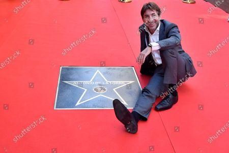 Antonio de la Torre poses next to his 'star' at the fame avenue in Almeria after receiving the 'Almeria Tierra de Cine' award at Almeria's International Film Festival, in Almeria, Spain, 19 November 2020.