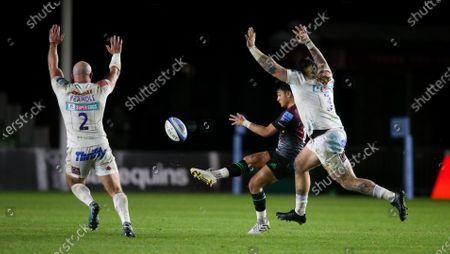 Marcus Smith of Harlequins kicks into space past Jack Yeandle (Captain) of Exeter & Harry Williams of Exeter