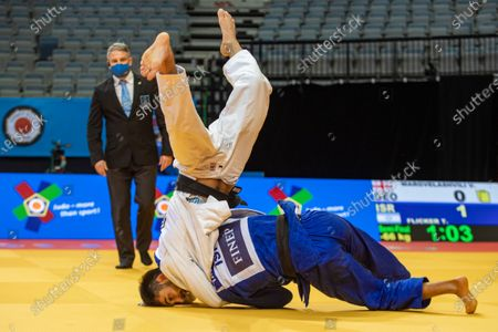 Tal Flicker of Israel (R) and Vazha Margvelashvili of Georgia (R) in action during the semifinal match in the men's -66kg category at the 2020 European Judo Championships in Prague, Czech Republic, 19 November 2020.
