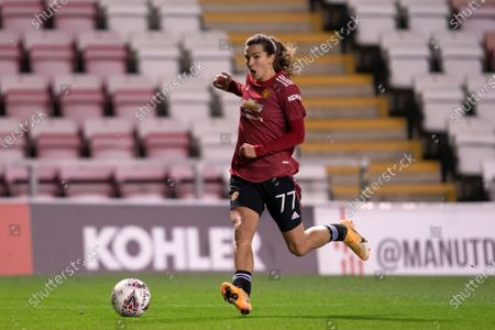 Tobin Heath of Manchester United Women takes the ball downfield
