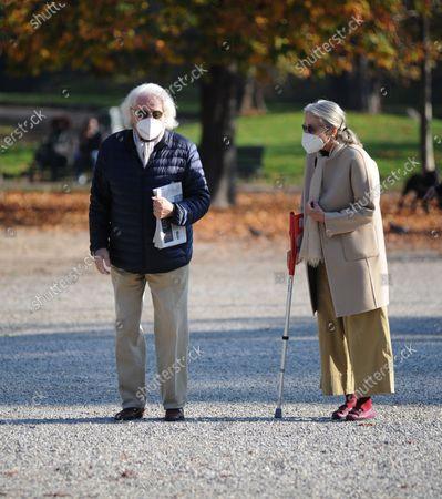 Stock Image of Giorgio Forattini and wife Ilaria Cerrina Feroni take a lunchtime walk in Montanelli park