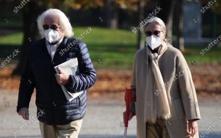 Stock Picture of Giorgio Forattini and wife Ilaria Cerrina Feroni take a lunchtime walk in Montanelli park