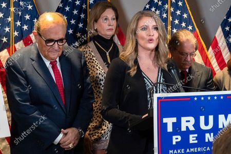 Members of President Donald Trump's legal team, including former Mayor of New York Rudy Giuliani, left, Sidney Powell, and Jenna Ellis, speaking, attend a news conference at the Republican National Committee headquarters, in Washington