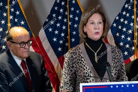 Sidney Powell, right, speaks next to former Mayor of New York Rudy Giuliani, as members of President Donald Trump's legal team, during a news conference at the Republican National Committee headquarters, in Washington