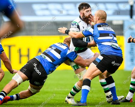 Stock Image of Miles Reid and Jack Walker of Bath Rugby tackle Gary Graham of Newcastle Falcons during the Gallagher Premiership match between Bath Rugby and Newcastle Falcons, 21 November 2020.