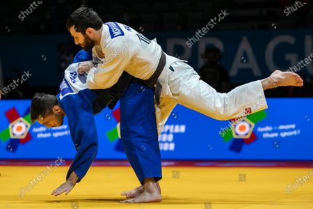 Yago Abuladze (blue) and Robert Mshvidobadze (white), both of Russia, in action during their final bout of the men's -60kg category at the European Judo Championships in Prague, Czech Republic, 19 November 2020.