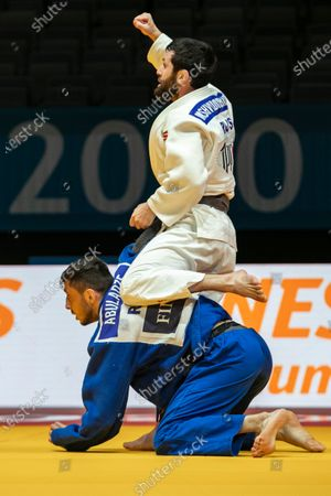 Robert Mshvidobadze (white) of Russia celebrates after defeating his compatriot Yago Abuladze (blue) in their final bout of the men's -60kg category at the European Judo Championships in Prague, Czech Republic, 19 November 2020.