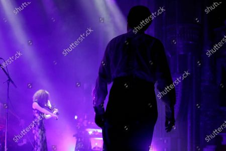 """Dave Vanian and Emily Vanian perform on stage during """"The Damned: A Night Of A Thousand Vampires"""" at The Palladium"""