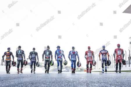 ALGARVE INTERNATIONAL CIRCUIT, PORTUGAL - NOVEMBER 19: Nine winners of 2020: Maverick Vinales, Yamaha Factory Racing, Brad Binder, Red Bull KTM Factory Racing, Franco Morbidelli, Petronas Yamaha SRT, Andrea Dovizioso, Ducati Team, Joan Mir, Team Suzuki MotoGP, Miguel Oliveira, Red Bull KTM Tech 3, Alex Rins, Team Suzuki MotoGP, Danilo Petrucci, Ducati Team, Fabio Quartararo, Petronas Yamaha SRT during the Portuguese GP at Algarve International Circuit on November 19, 2020 in Algarve International Circuit, Portugal. (Photo by Gold and Goose / LAT Images)