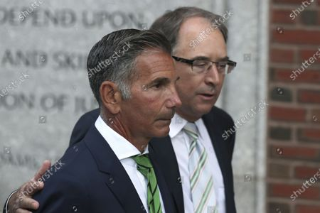 """Clothing designer Mossimo Giannulli, foreground, departs federal court in Boston, after facing charges in a nationwide college admissions bribery scandal. Giannulli has reported to prison to begin serving his five-month sentence for bribing his daughters' way into college. Giannulli's wife, """"Full House"""" actor Lori Loughlin, is already behind bars for her role in the college admissions bribery scheme involving prominent parents and elite schools across the country. She began her two-month prison term late last month"""