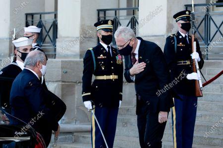 Acting US Secretary of Defense Christopher Miller (R) greets Foreign Minister for the Republic of Uzbekistan Abdulaziz Kamilov (L), before their meeting at the Pentagon in Arlington, Virginia, USA, 19 November 2020.