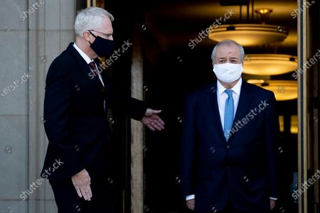 Acting US Secretary of Defense Christopher Miller (L) hosts an honor cordon to welcome Foreign Minister for the Republic of Uzbekistan Abdulaziz Kamilov (R), at the Pentagon in Arlington, Virginia, USA, 19 November 2020.