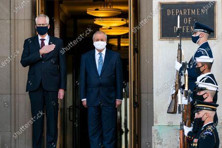 Acting Secretary of Defense Christopher Miller, left, hosts an honor cordon welcoming Uzbekistan's Foreign Minister Abdulaziz Kamilov at the Pentagon