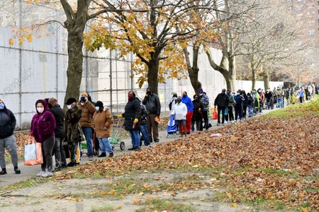 Residents line up for the NYPD 113th Precinct Turkey Giveaway