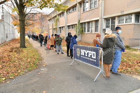 Editorial image of NYPD 113th Precinct Turkey Giveaway, New York, USA - 19 Nov 2020