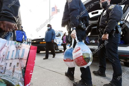 NYPD officers prepare for the 113th Precinct Turkey Giveaway