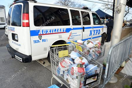 Stock Picture of NYPD officers prepare for the 113th Precinct Turkey Giveaway