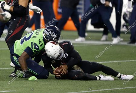 Seattle Seahawks defensive end Carlos Dunlap (43) sacks Arizona Cardinals quarterback Kyler Murray (1), late in the second half of an NFL football game, in Seattle. The Seahawks won 28-21