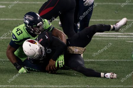Seattle Seahawks defensive end Carlos Dunlap II sacksl Arizona Cardinals quarterback Kyler Murray on fourth down late in the second half an NFL football game, in Seattle. The Seahawks won 28-21