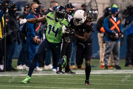 Seattle Seahawks wide receiver DK Metcalf battles Arizona Cardinals defensive back Dre Kirkpatrick for position during the first half an NFL football game, in Seattle. The Seahawks won 28-21