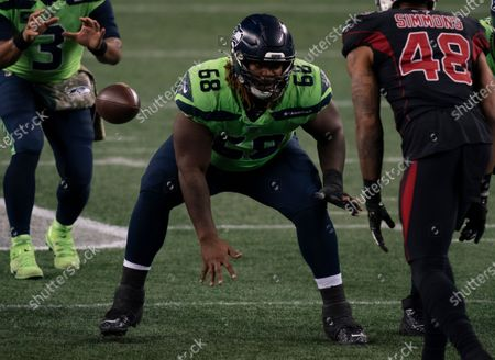 Seattle Seahawks offensive lineman Damien Lewis snaps the ball during the second half an NFL football game against the Arizona Cardinals, in Seattle. The Seahawks won 28-21