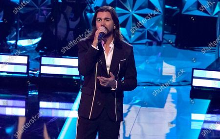Stock Picture of Juanes performs during the living legends tribute to Roberto Carlos at the 21st Latin Grammy Awards, airing, at American Airlines Arena in Miami