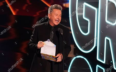 Ricardo Montaner presents the award for album of the year to Natalia Lafourcade at the 21st Latin Grammy Awards, airing, at American Airlines Arena in Miami