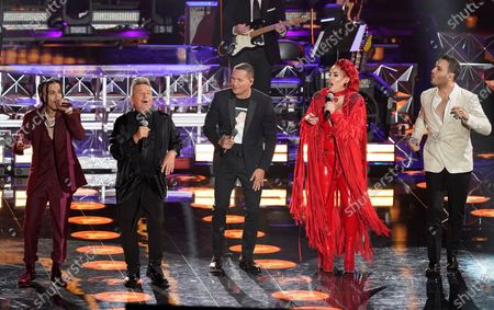 Rauw Alejandro, from left, Ricardo Montaner, Victor Manuelle, Ivy Queen, and Jesus Navarro perform at the 21st Latin Grammy Awards, airing, at American Airlines Arena in Miami