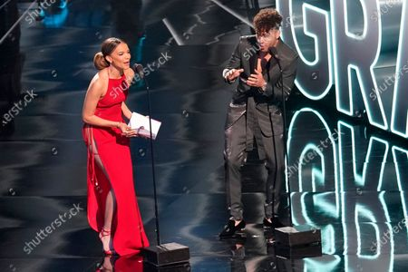 Leslie Grace, left, and Prince Royce speak onstage at the 21st Latin Grammy Awards, airing, at American Airlines Arena in Miami