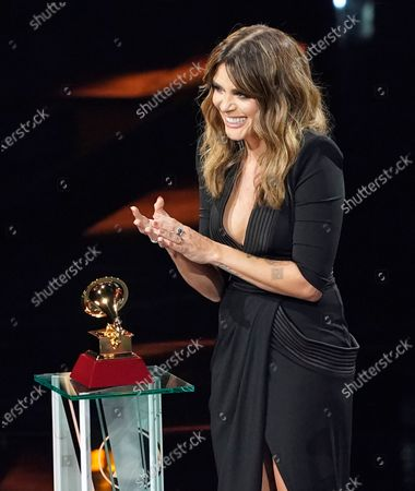 """Kany Garcia accepts the award for best singer- songwriter album for """"Mesa Para Dos"""" at the 21st Latin Grammy Awards, airing, at American Airlines Arena in Miami"""