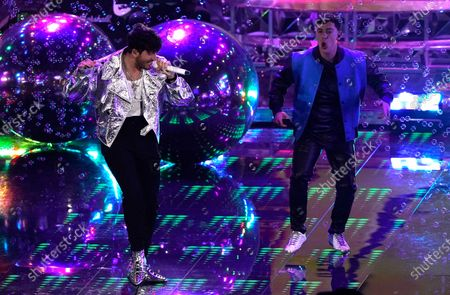 Stock Picture of Sebastian Yatra, left, and Guaynaa perform at the 21st Latin Grammy Awards, airing, at American Airlines Arena in Miami