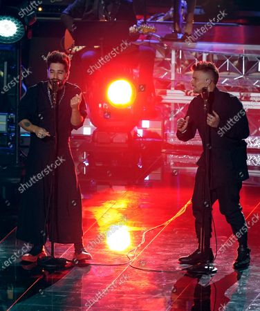 Camilo, left, and Pedro Capo perform at the 21st Latin Grammy Awards, airing, at American Airlines Arena in Miami