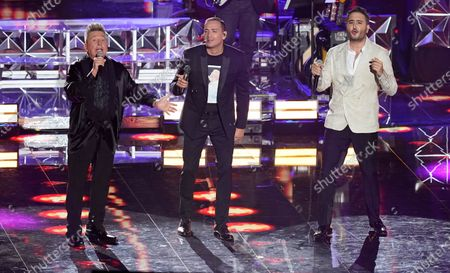 Ricardo Montaner, from left, Victor Manuelle and Jesus Navarro perform at the 21st Latin Grammy Awards, airing, at American Airlines Arena in Miami