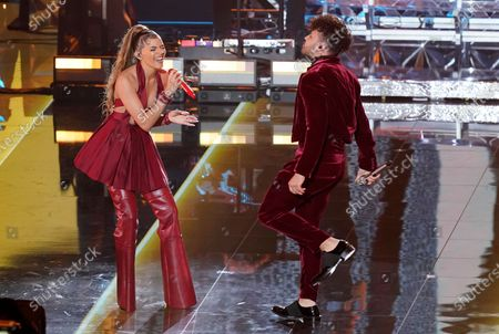 Leslie Grace, left, and Prince Royce perform during a living legends tribute to Juan Luis Guerra at the 21st Latin Grammy Awards, airing, at American Airlines Arena in Miami