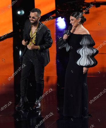 Stock Photo of Mike Bahia, left, and Ana Brenda Contreras speak at the 21st Latin Grammy Awards, airing, at American Airlines Arena in Miami